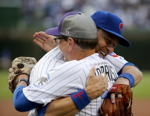 Chicago Cubs' Ben Zobrist, right, hugs his father Tom before his father threw out a ceremonial first pitch to him before a baseball game between the Cubs and the Colorado Rockies Thursday, June 8, 2017, in Chicago. (AP Photo/Charles Rex Arbogast)