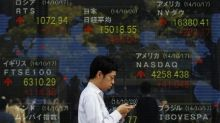 Asian Equities Fall as Investors Await Powell's Second Appearance