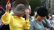 Guests battle the winds at Princess Eugenie and Jack Brooksbank's wedding
