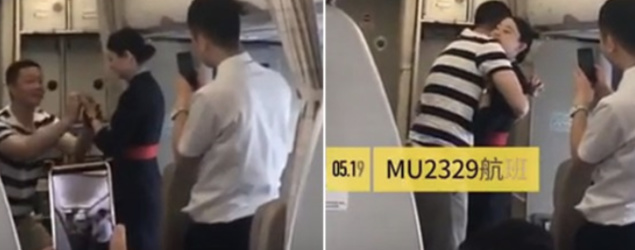 A flight attendant has been fired after her boyfriend proposed to her during a flight. (YouTube/PearVideo)