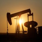 Oil steady as hopeful economic data face spike in virus cases