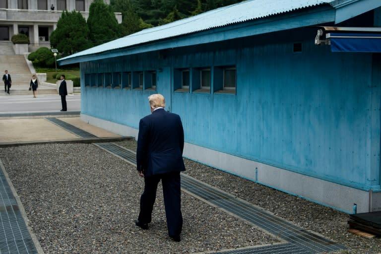 US President Donald Trump walks to the line of demarcation to meet North Korea's leader Kim Jong Un (AFP Photo/Brendan Smialowski)