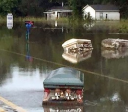 Coffins Unearthed by Deadly Flood Waters Spotted Floating Down Residential Streets