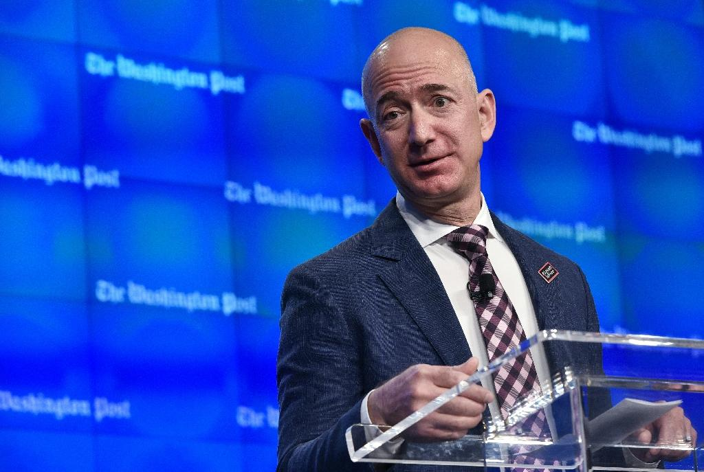 Most of his fortune is from Amazon shares, but Jeff Bezos also owns the Washington Post -- where he spoke at the newspaper's new headquarters inauguration in 2016 (AFP Photo/Mandel Ngan)