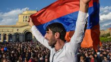 Armenia celebrates as veteran leader quits amid protests