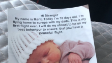 Two dads gave out goody bags on 10-hour flight with their new baby