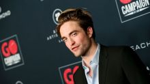 Robert Pattinson photographs himself for the cover of GQ