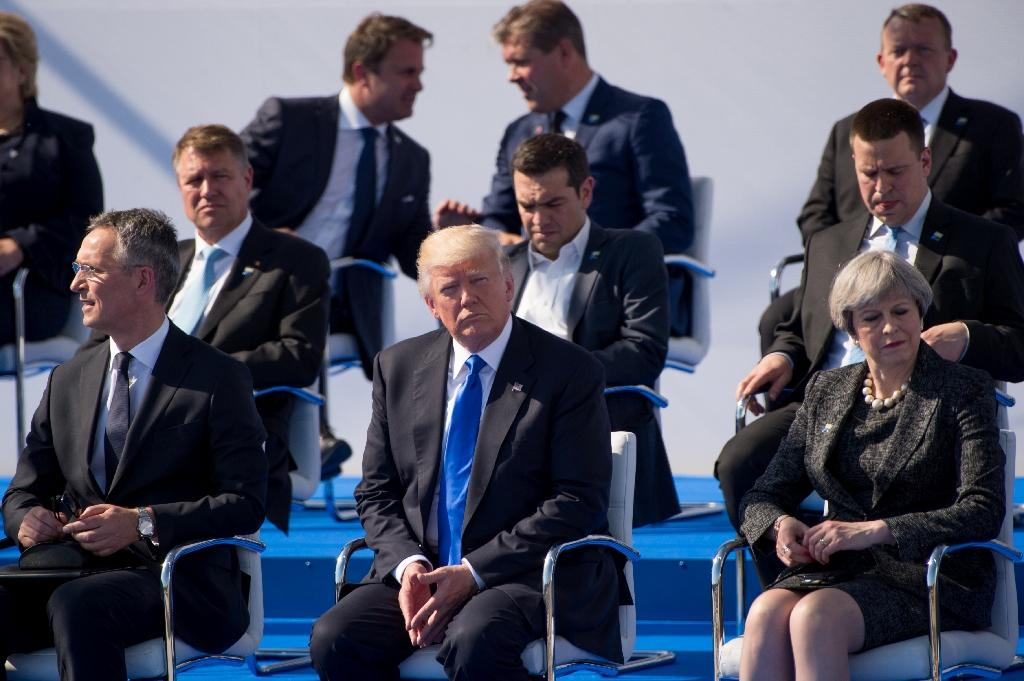 (L-R) NATO Secretary General Jens Stoltenberg, US President Donald Trump and British Prime Minister Theresa May attend the handover ceremony of the new headquarters of NATO in Brussels, on May 25, 2017 (AFP Photo/Melanie Wenger)