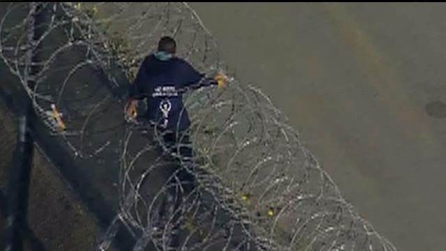 Man Stuck In Barbed Wire While Crossing Over The Border Fence