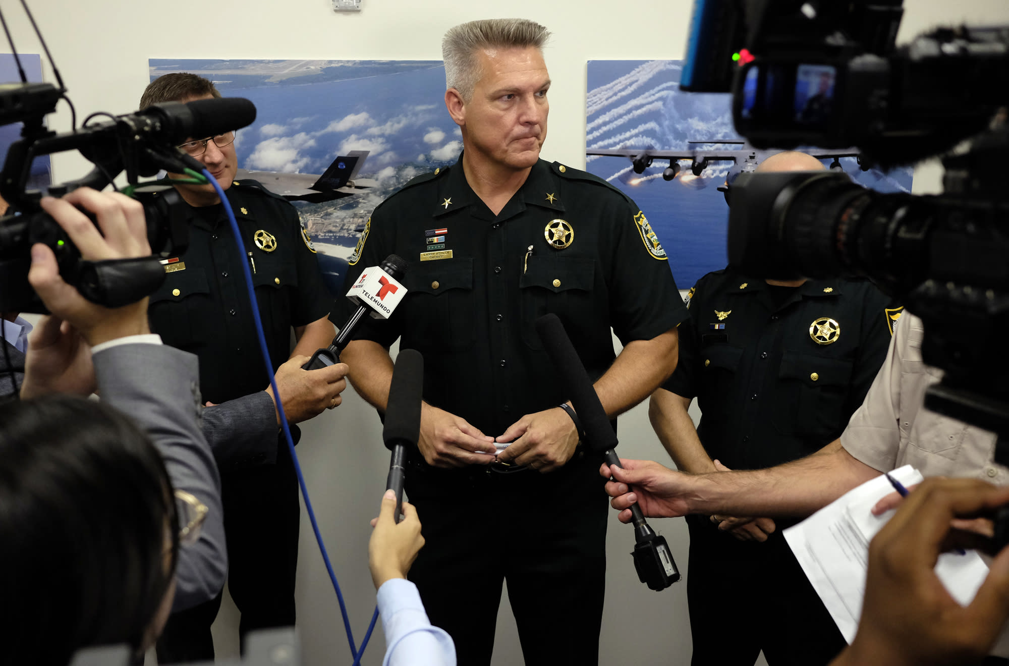 Okaloosa County, Fla.,Sheriff Larry Ashley fields questions from the media after Florida Gov. Ron DeSantis signed the Sanctuary City bill, Friday, June 14, 2019 at the Okaloosa County Commission Chambers in Shalimar Fla. The bill, signed by DeSantis, requires all law enforcement agencies in Florida to cooperate with federal immigration authorities. (Michael Snyder/Northwest Florida Daily News via AP)