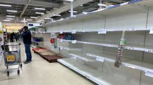 British supermarkets impose limits as panic buying spreads