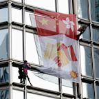 French 'spiderman' Alain Robert climbs Hong Kong skyscraper to unfurl 'peace banner'