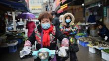 Chine: villes bouclées au coeur de l'épidémie, le bilan grimpe