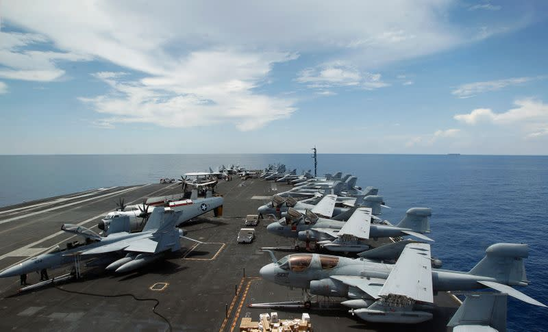 FILE PHOTO: A general view of the aircrafts on the flight deck during a tour of the USS Nimitz aircraft carrier on patrol in the South China Sea