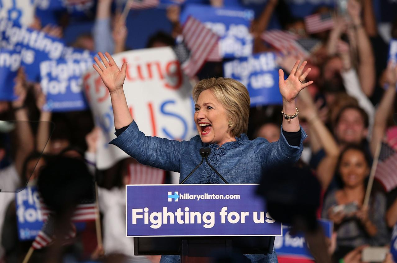 <p>Democratic presidential candidate Hillary Clinton celebrates her victory at a primary night event at the Palm Beach County Convention Center in West Palm Beach, Fla. <i> (Photo: Joe Raedle/Getty Images)</i></p>