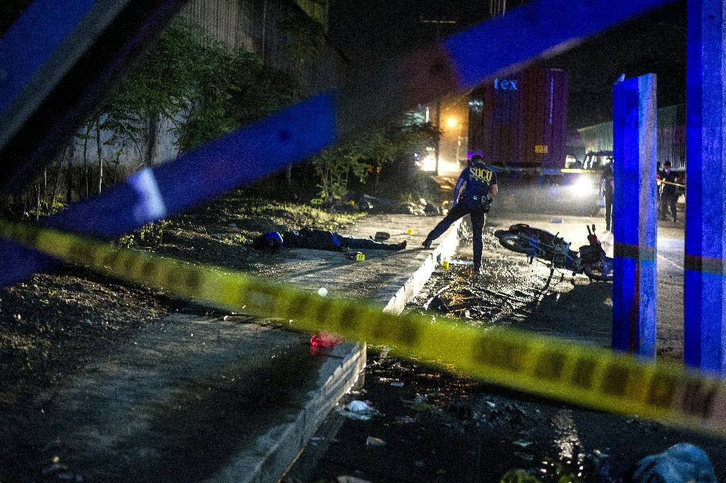 Philippine President Rodrigo Duterte's law-and-order crackdown has left more than 4,800 people dead since he took power in July 2016 (AFP Photo/Noel Celis)