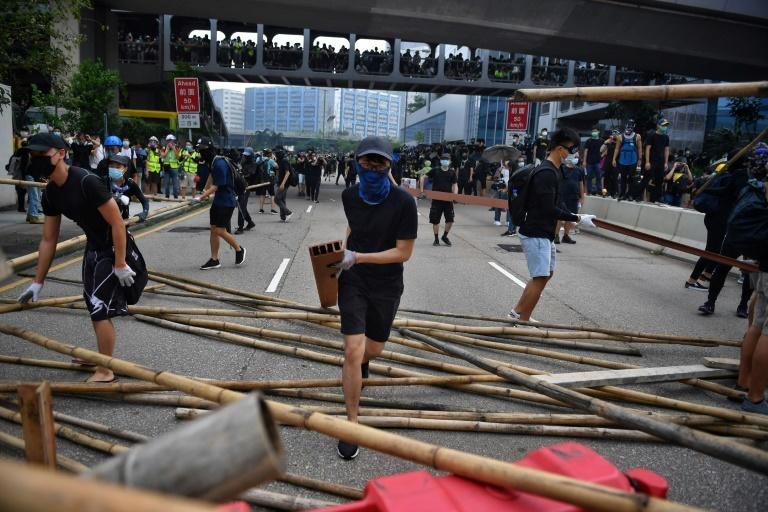 Thousands of demonstrators marched through an industrial area, where they were blocked by dozens of riot police with shields and batons (AFP Photo/Lillian SUWANRUMPHA)