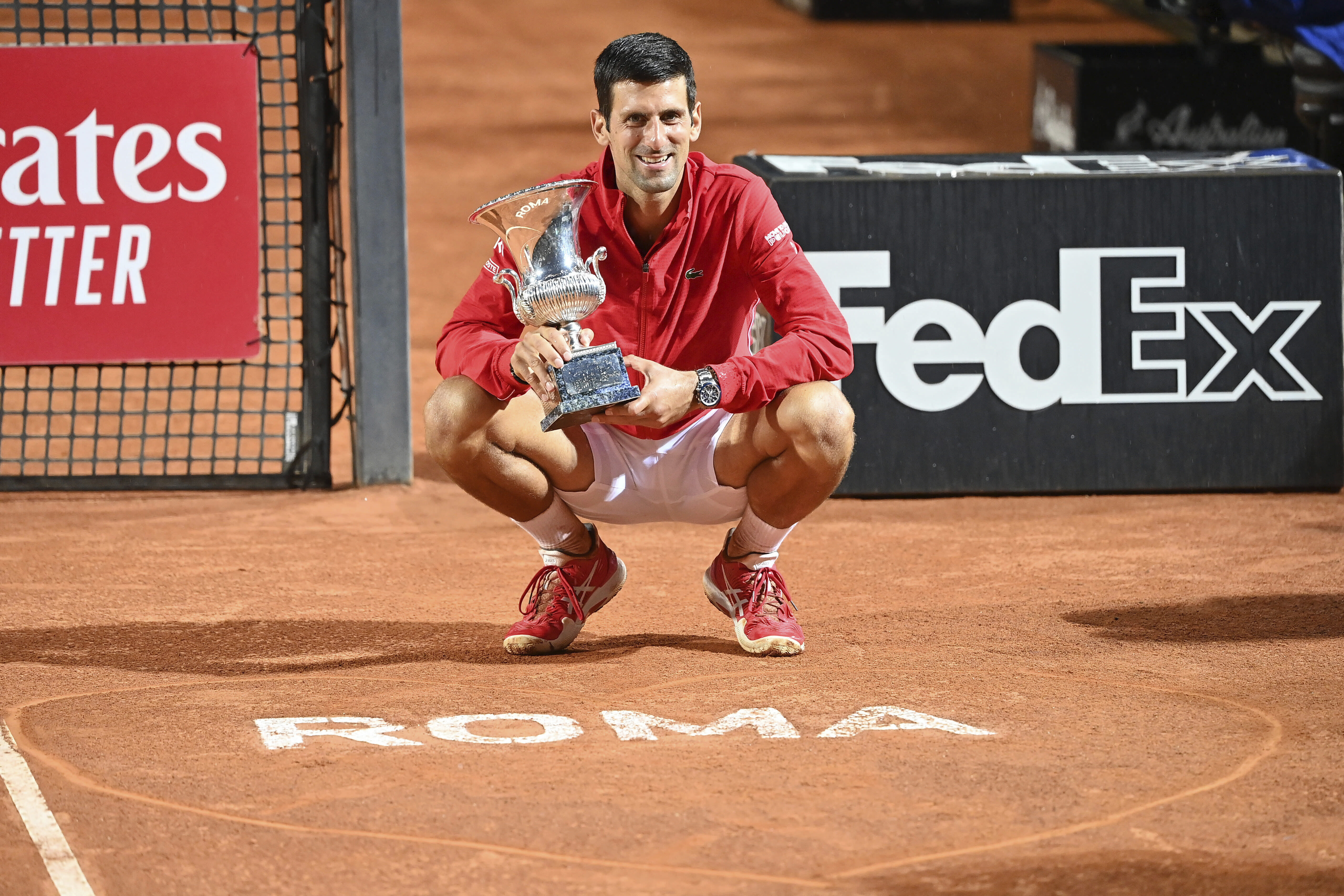Serbia's Novak Đjoković poses with his trophy after winning winning his match with Argentina's Diego Sebastián Schwartzman during their final match at the Italian Open tennis tournament, in Rome, Monday, Sept. 21, 2020. (Alfredo Falcone/LaPresse via AP)