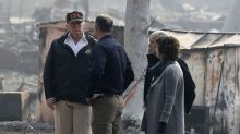 Trump sees wildfire areas, consoles those harmed by shooting