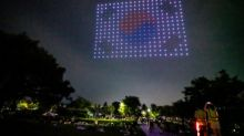 Hundreds of drones light up Seoul sky with virus messages
