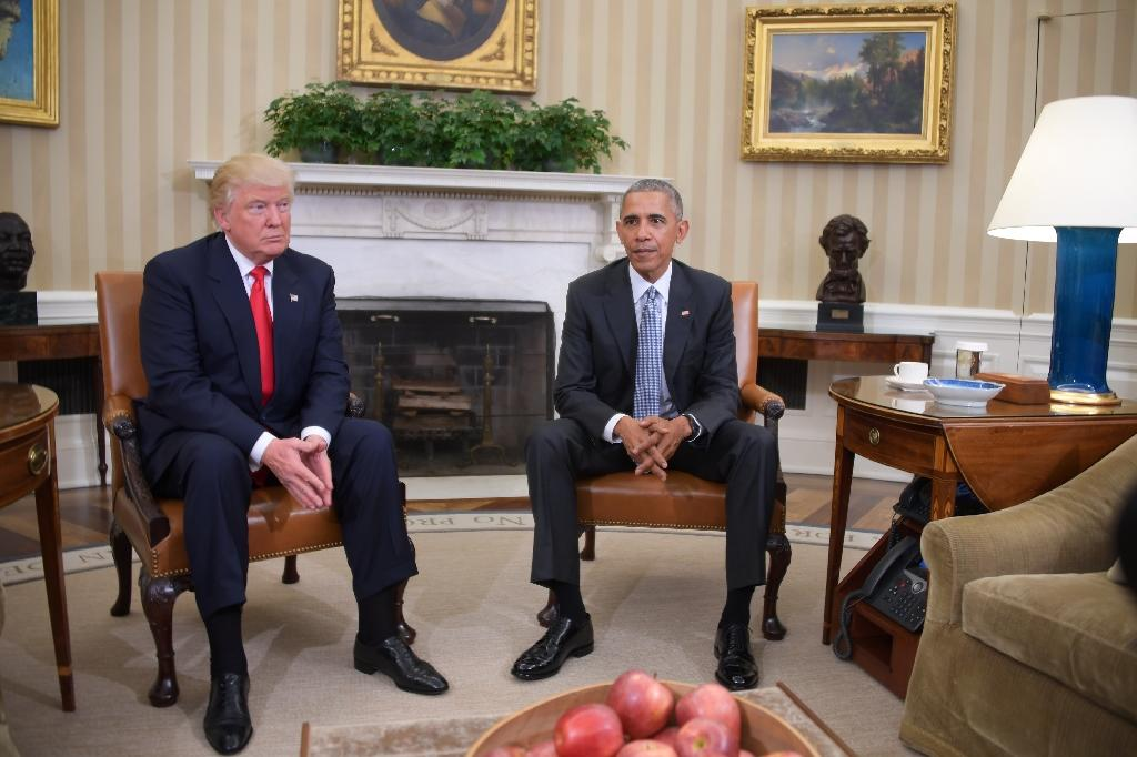 US President Barack Obama meets with President-elect Donald Trump to update him on transition planning in the Oval Office at the White House on November 10, 2016