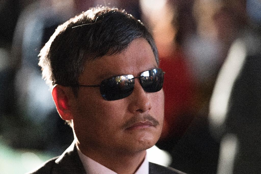 "Chen Guangcheng, a lawyer and activist imprisoned for speaking out against forced abortions in rural China who now lives in the US, says Beijing ""deliberately killed"" Nobel laureate Liu Xiaobo by not allowing him to seek treatment abroad (AFP Photo/JIM WATSON)"
