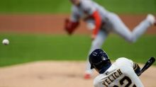 Brewers rally to edge Cardinals 2-1 in doubleheader opener