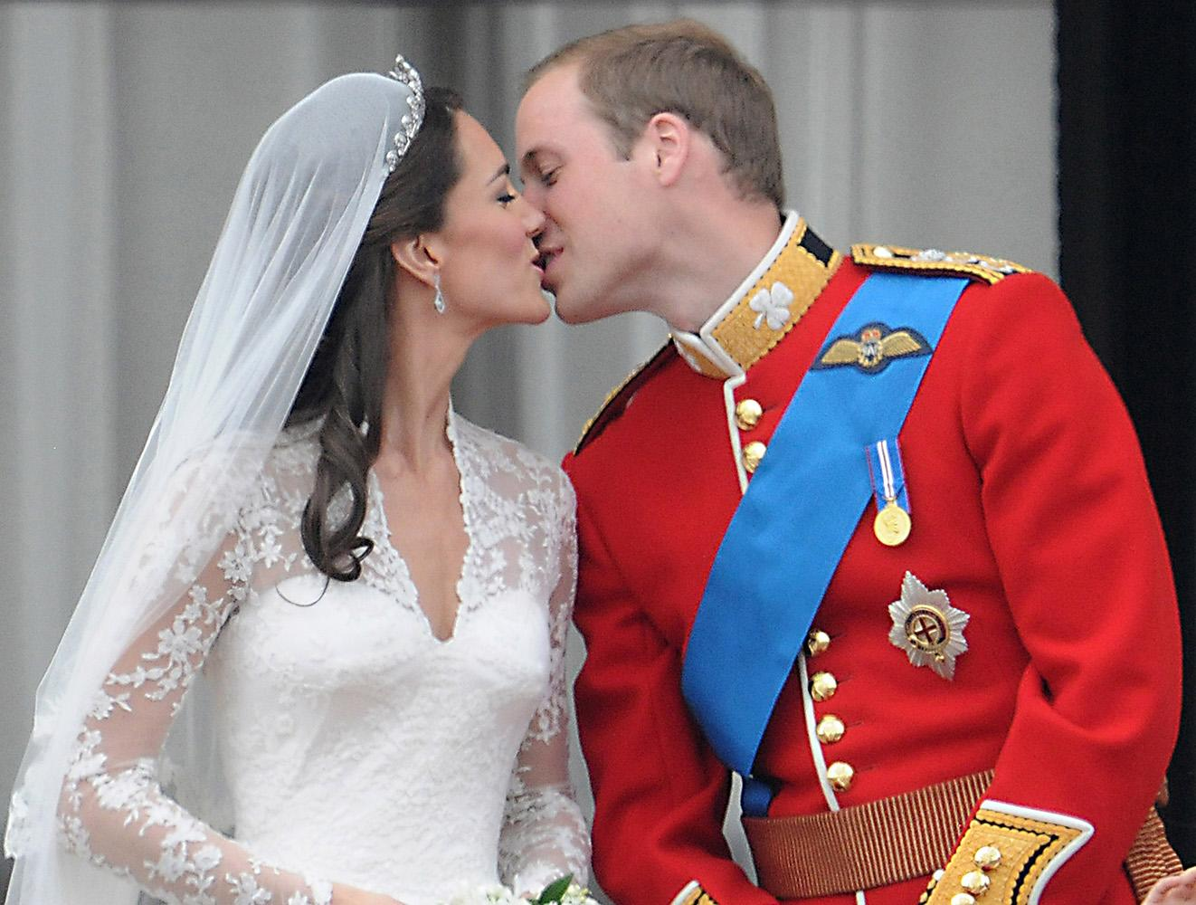 The new Duke and Duchess of Cambridge kiss on the balcony of Buckingham Palace to cheers from the crowd.