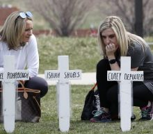 The Latest: 12 students,1 teacher killed honored at ceremony