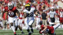 Michigan blows late lead, but survives Indiana in OT