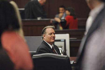 Michael Dunn looks at his family during his murder trial in the shooting death of unarmed teen Jordan Davis, in Duval County Courthouse in Jacksonville, Florida February 10, 2014. Dunn is accused of first degree murder in death of Davis after an altercation over loud rap music at a Florida gas station in November 2012. REUTERS/Bob Mack/Pool