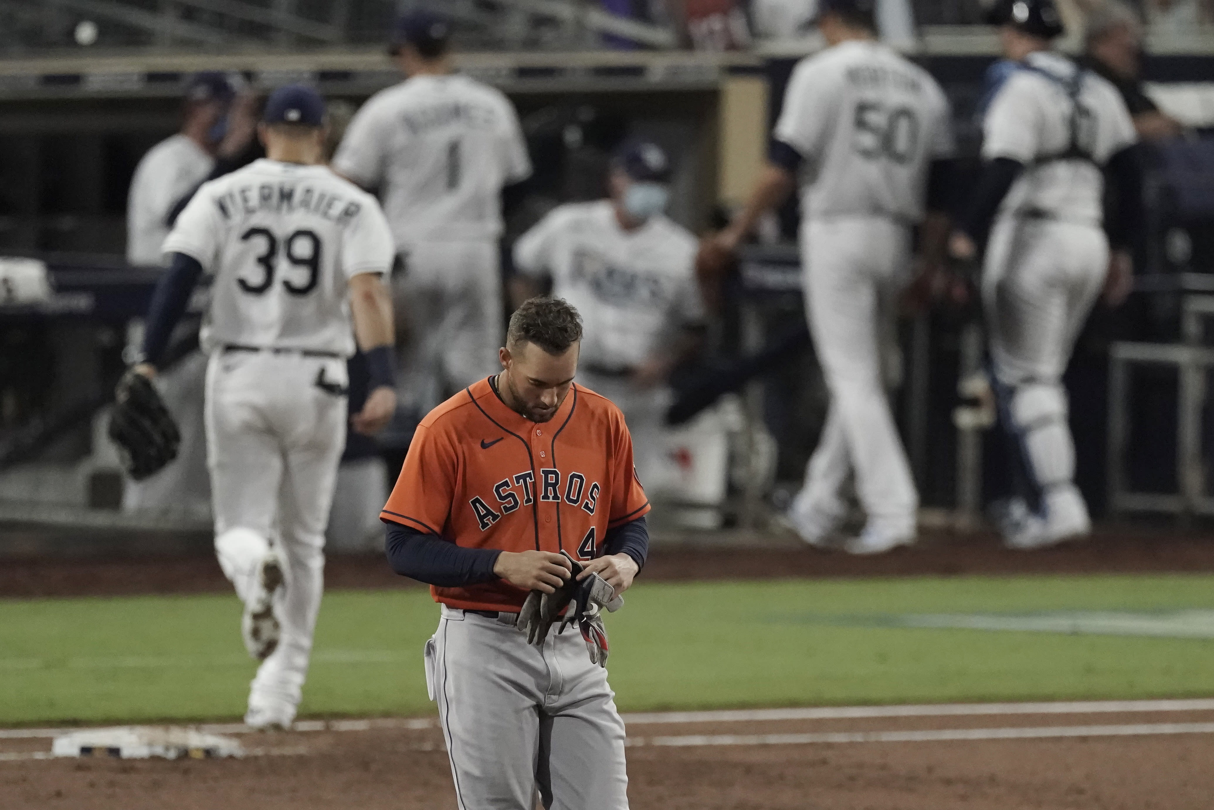 Houston Astros George Springer walks back to the dugout after grounding out against the Tampa Bay Rays during the third inning in Game 7 of a baseball American League Championship Series, Saturday, Oct. 17, 2020, in San Diego. (AP Photo/Jae C. Hong)