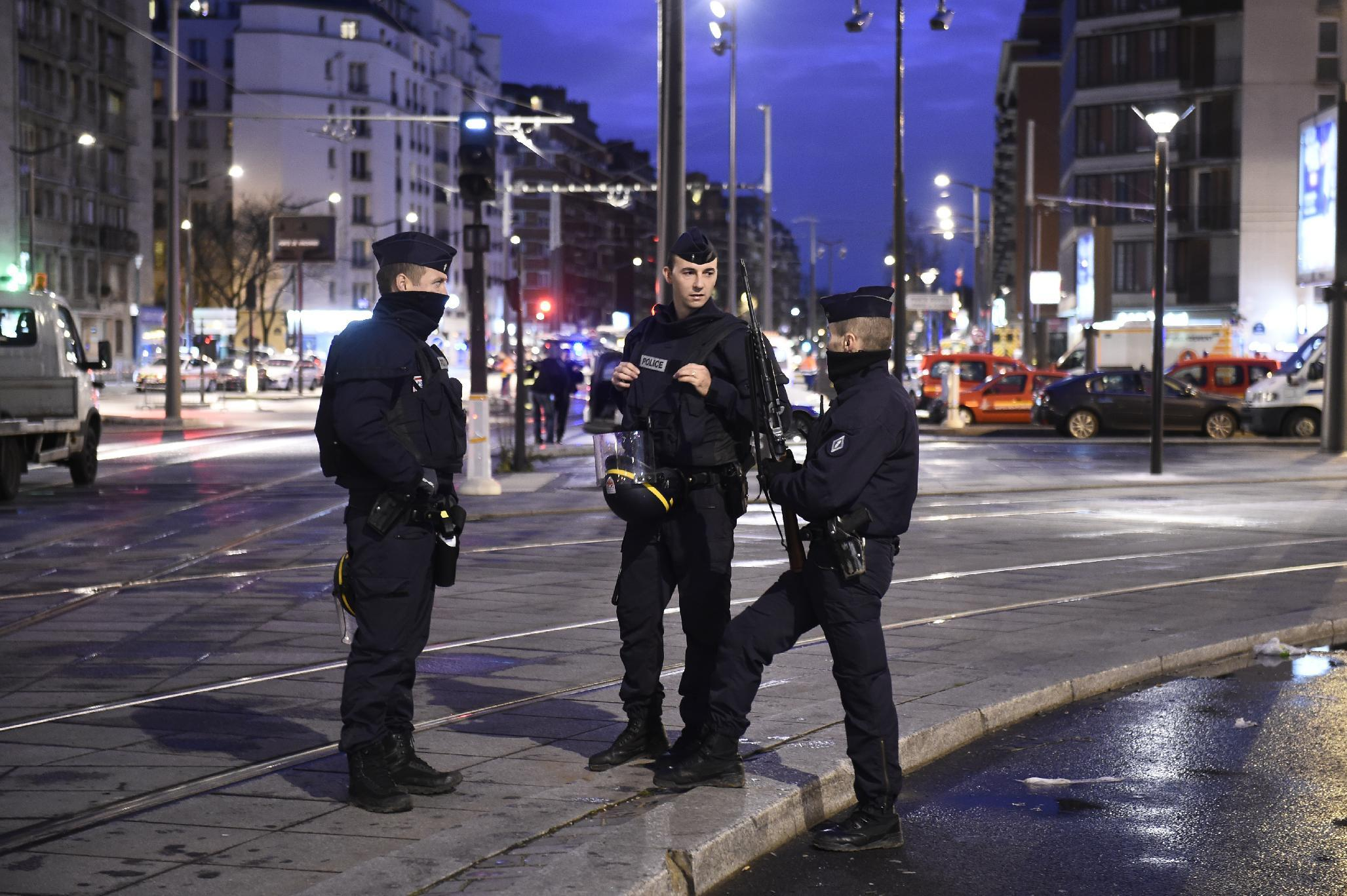 French police stand guard near Porte de Vincennes, eastern Paris, on January 9, 2015, before an assault on a kosher grocery store where a gunman had taken hostages