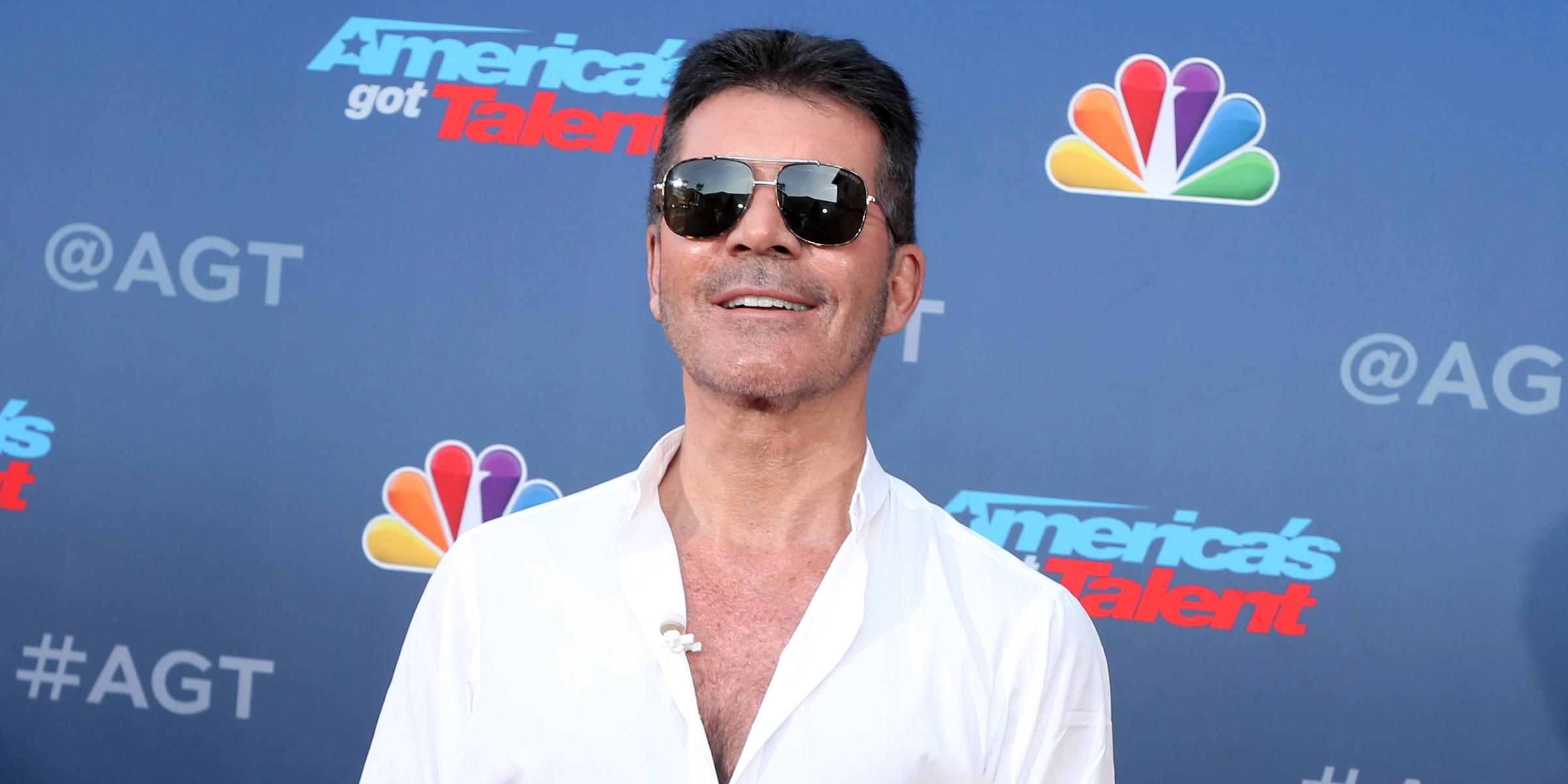 Simon Cowell breaks his back in electric bike fall
