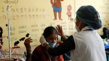 India gingerly eases coronavirus rules as new cases dip to two-month low