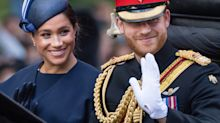 Glowing Prince Harry and Meghan Markle attend an MLB game in London