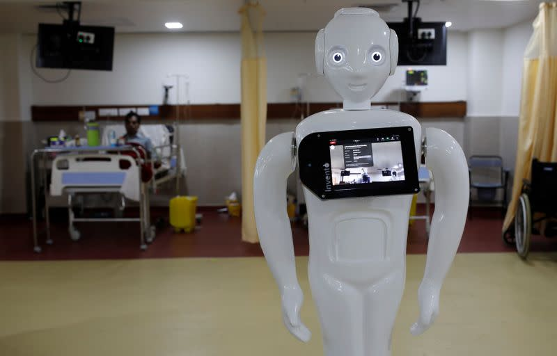 A robot named 'Mitra', which is used by the patients suffering from the coronavirus disease (COVID-19) to communicate with their relatives, is seen inside an Intensive Care Unit (ICU) of a hospital in Noida