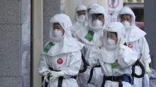 Wuhan ends lockdown as health workers buckle under strain