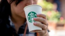 Starbucks to charge British customers for using paper cups