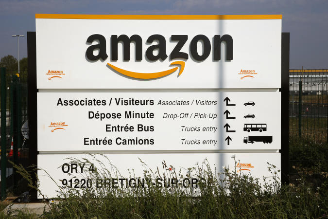 """BRETIGNY-SUR-ORGE, FRANCE - APRIL 13: The logo of Amazon is seen at the entrance of the company logistics center on April 13, 2020 in Bretigny-sur-Orge, France. The French government has ordered the American e-commerce giant Amazon to take measures at four of its sites in France to better protect Covid-19 employees. Amazon has been summoned by the """"Sud-Solidaires"""" union, which is calling for the closure of warehouses to protect employees from possible coronavirus contamination. The court decision will be rendered on Tuesday April 14 by the Nanterre court. The Coronavirus (COVID-19) pandemic has spread to many countries across the world, claiming over 115,000 lives and infecting over 1.8 million people. (Photo by Chesnot/Getty Images)"""