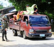 Thousands flee Philippine city after rebel rampage claimed by Islamic State