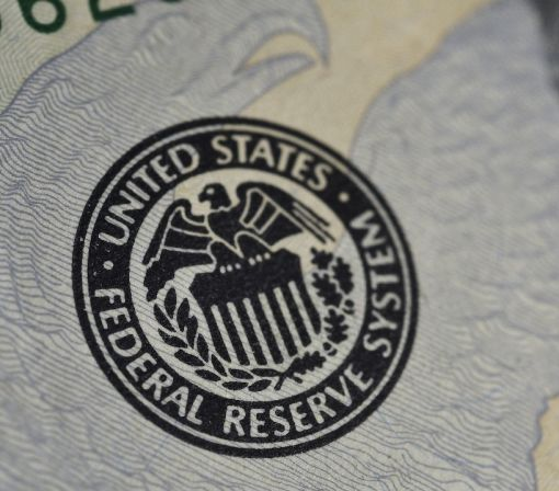Fed leaves rates unchanged but says US economy improving