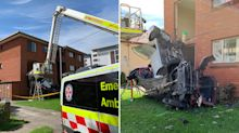 Incredible scenes as two cars fly into unit block