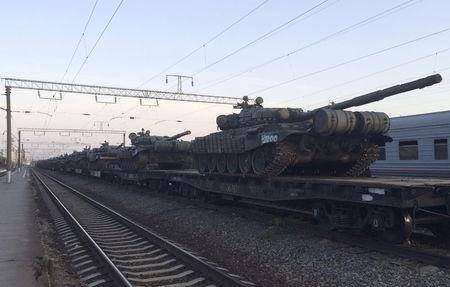 Tanks are seen on a freight train shortly after its arrival at a railway station in the Russian southern town of Matveev Kurgan, near the Russian-Ukrainian border in Rostov region, Russia, May 26, 2015. Picture taken with a mobile phone. REUTERS/Maria Tsvetkova