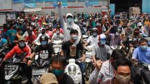 Indonesia police arrest more than 20 as thousands protest against new jobs law