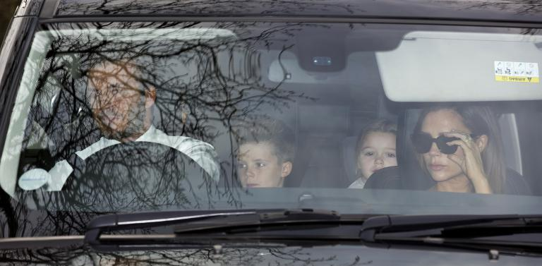 David Beckham (L) and his wife Victoria (R) arrive with their family to attend Elton John's wedding to his partner David Furnish at their mansion in Windsor, on December 21, 2014 (AFP Photo/Justin Tallis)
