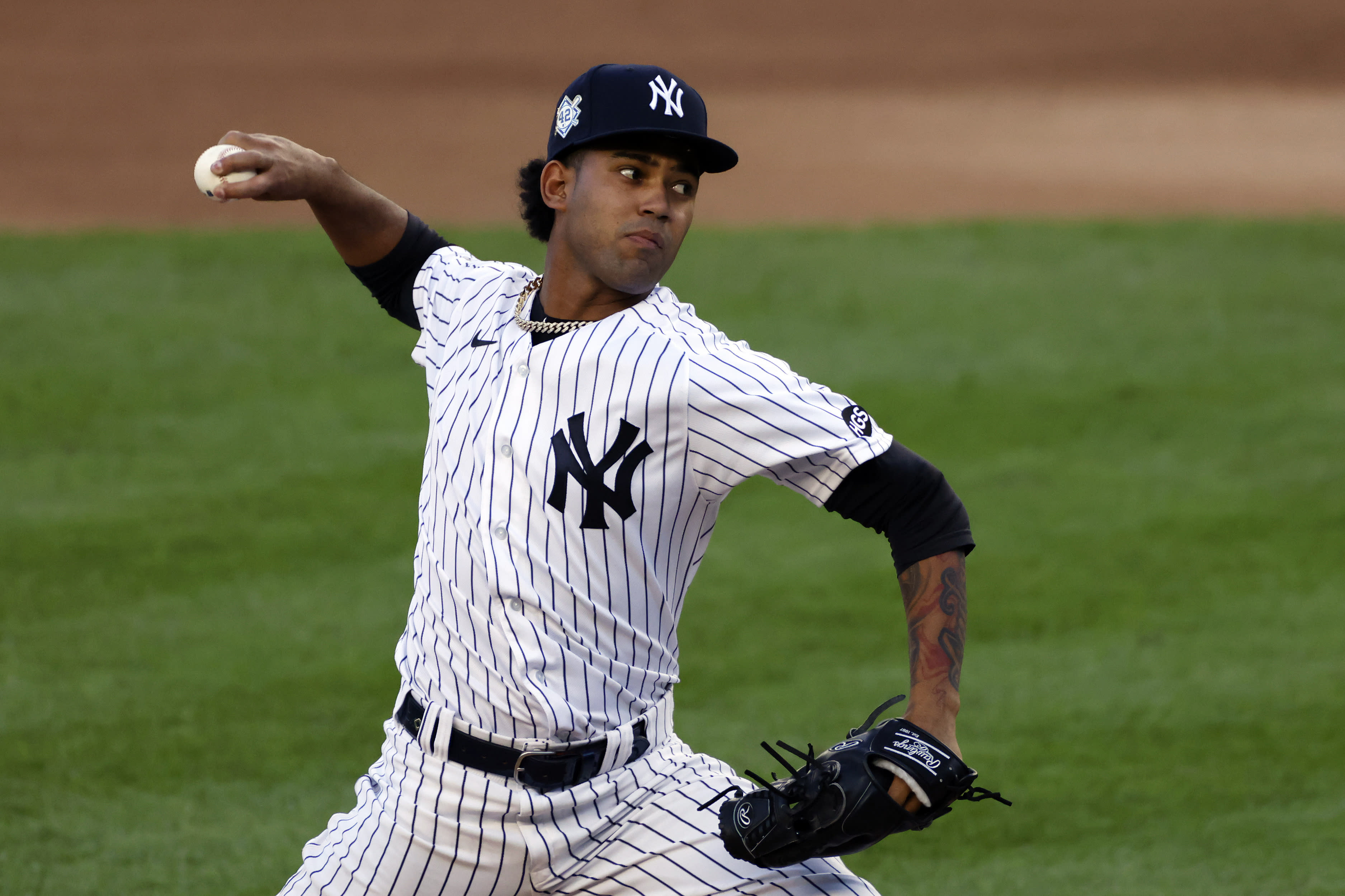 New York Yankees pitcher Deivi García delivers against the New York Mets during the third inning of the second baseball game of a doubleheader, Sunday, Aug. 30, 2020, in New York. (AP Photo/Adam Hunger)