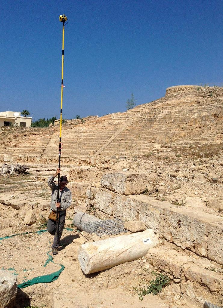 A member of an Australian archaeological team, conducting a pole photograph survey in Nea Paphos, on Cyprus' southwestern coast, at the site of an uncovered Hellenistic-Roman theatre dating from 300 BC on September 17, 2015