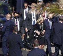 Bidens surprise UK churchgoers by showing up to Mass