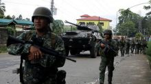 Bodies of civilians dumped near Philippines city besieged by Islamists